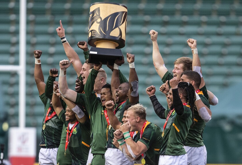 South Africa celebrates the gold medal win over Great Britain in a Canada Sevens gold medal rugby match, in Edmonton, Alberta, Sunday, Sept. 26, 2021. (Jason Franson/The Canadian Press via AP)