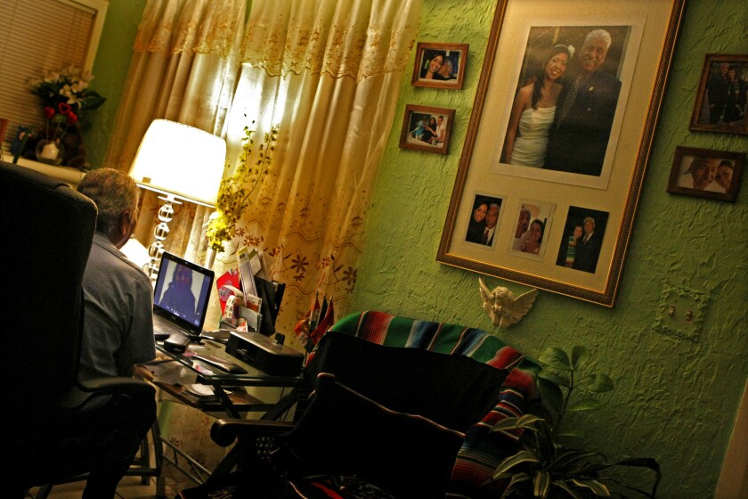 Gerardo Herrejon talks to Ana in his home, which the Glendale bus driver has decorated with photographs of the couple.