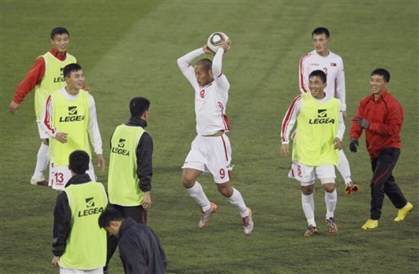 North Korea's Jong Tae Se, center plays with his teammates during a team training session in Tembisa, South Africa, Friday June 11, 2010. North Korea are preparing for the upcoming soccer World Cup, where they will play in Group G.  (AP Photo/Kin Cheung)
