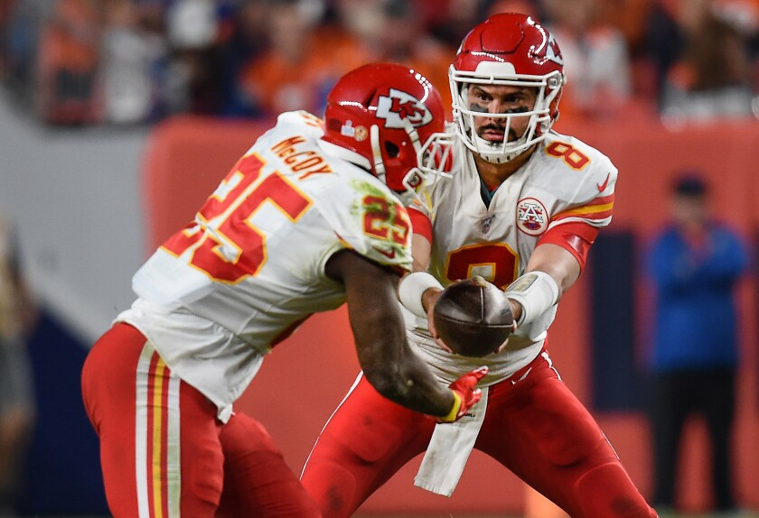 Kansas City Chiefs quarterback Matt Moore (8) hands off to running back LeSean McCoy (25) during the second half against the Denver Broncos on Thursday. Moore was an assistant coach with Hart when the Chiefs convinced him to return to the NFL.