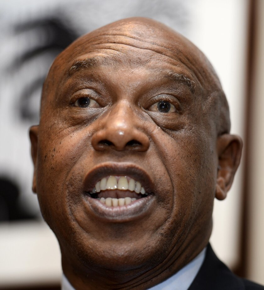 FILE - This is a Monday, Nov. 23, 2015 file photo of Tokyo Sexwale from South Africa speaks during a press conference in Copenhagen. The Confederation of African Football said Friday  it is backing Sheikh Salman of Bahrain in this month's FIFA presidential election. The decision also means CAF has