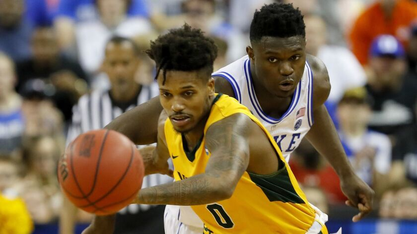 North Dakota State's Vinnie Shahid, left, is pursued by Duke's Zion Williamson in the second half during the first round of the NCAA Men's tournament at on Friday in Columbia, S.C.