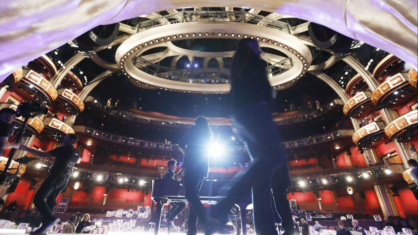 Oscar show director Glenn Weiss, center, works onstage with stage managers and steadicam operators in the Dolby Theatre during rehearsals for the 91st Oscars show Sunday.