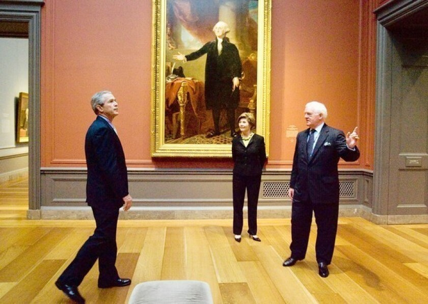 """The National Gallery of Art's strong suit is not modern art. Here, then-President George W. Bush and his wife Laura receive a tour of a Gilbert Stuart exhibition at the NGA from Director Earl """"Rusty"""" Powell, formerly of LACMA, in 2005."""