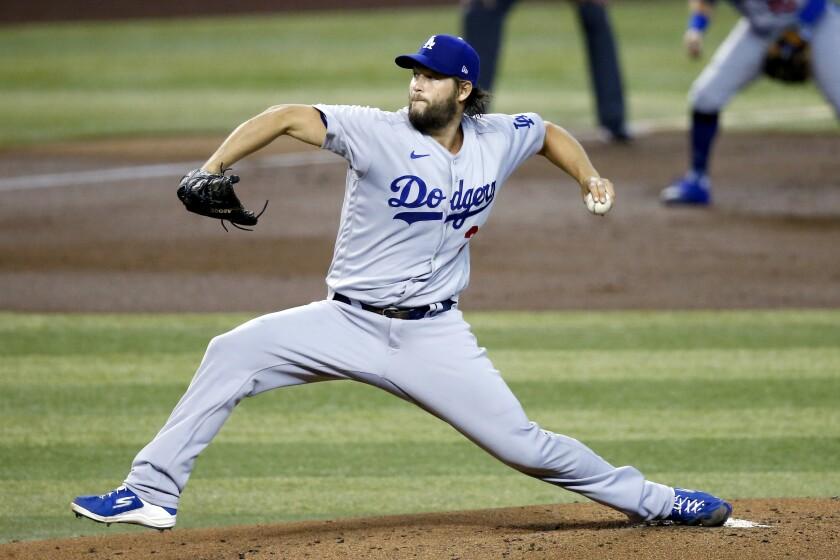 Dodgers starting pitcher Clayton Kershaw throws against the Arizona Diamondbacks.