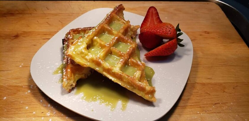 Waffles with butter and strawberries from Arize Bistro
