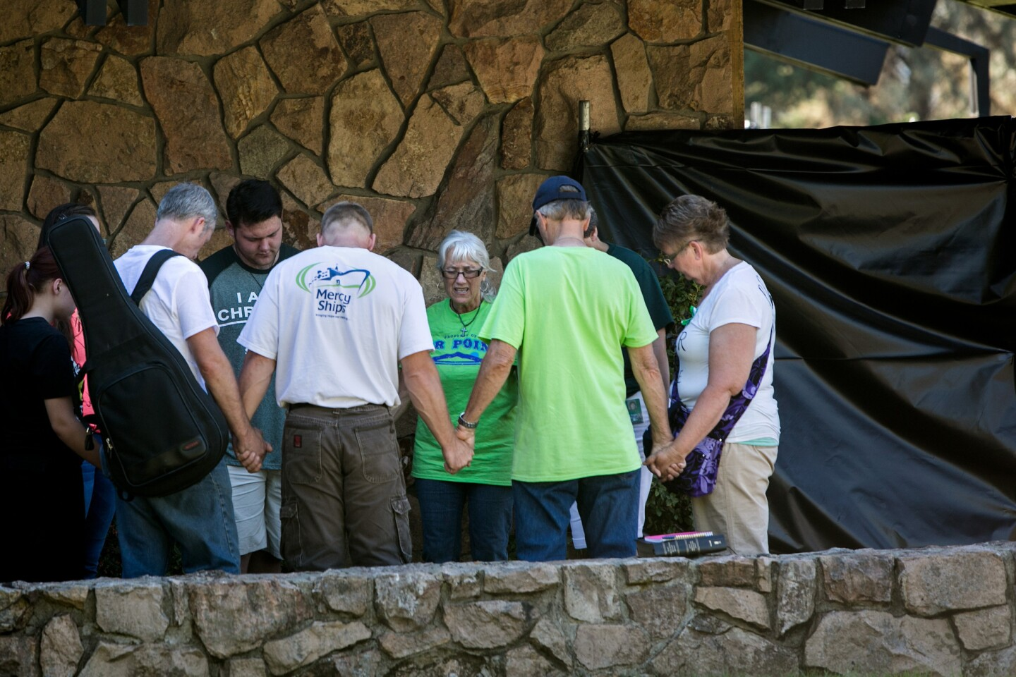 A prayer circle is held Oct. 5 at Snyder Hall, the site of the Umpqua Community College mass shooting.