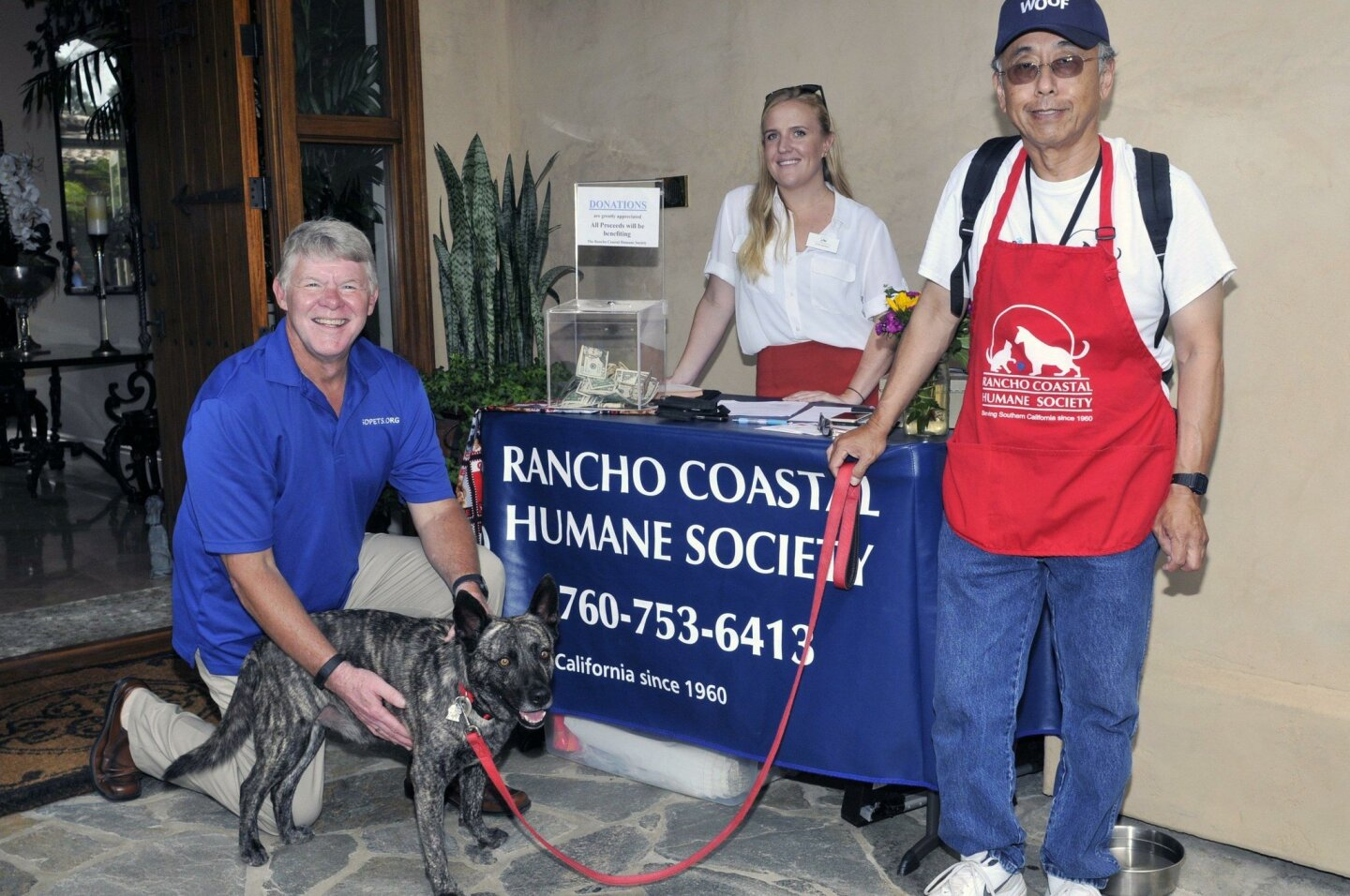 Rancho Coastal Humane Society PR Director John Van Zante, Events & Foster Coordinator Kelly Peters, Volunteer Bob Nouchi, and adoptable Max