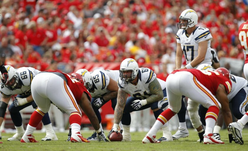 Quarterback Philip Rivers surveys the Chiefs defense at the line of scrimmage. Rivers threw two touchdown passes in the victory.
