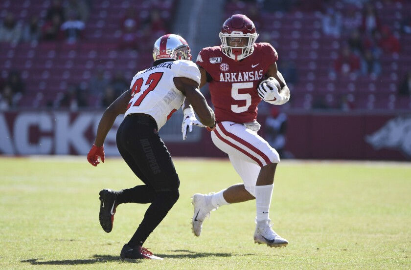 FILE - In this Nov. 9, 2019, file photo, Arkansas running back Rakeem Boyd carries against Western Kentucky during the second half of an NCAA college football game in Fayetteville, Ark. After a promising 2018, Boyd was a breakout star in the Southeastern Conference with 1,133 yards rushing and eight touchdowns last season. (AP Photo/Michael Woods, File)