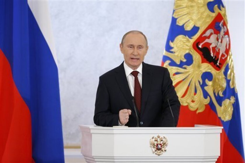 Russian President Vladimir Putin gestures during a state-of-the nation address in Moscow, Wednesday, Dec. 12, 2012. Putin on Wednesday angrily rejected what he described as attempts to enforce foreign patterns of democracy on Russia and vowed to preserve the nation's identity against interference from abroad. Putin's speech was his first state-of-the nation address since winning a third term in March's election despite a wave of massive protests in Moscow. (AP Photo/Alexander Zemlianichenko)