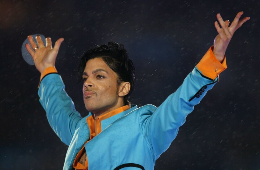 Prince performs during the halftime show of the NFL's Super Bowl XLI football game between the Chicago Bears and the Indianapolis Colts in Miami, Florida, February 4, 2007. Prince has died at the age of 57, according to news reports.    REUTERS/Mike Blake/Files ** Usable by SD ONLY **