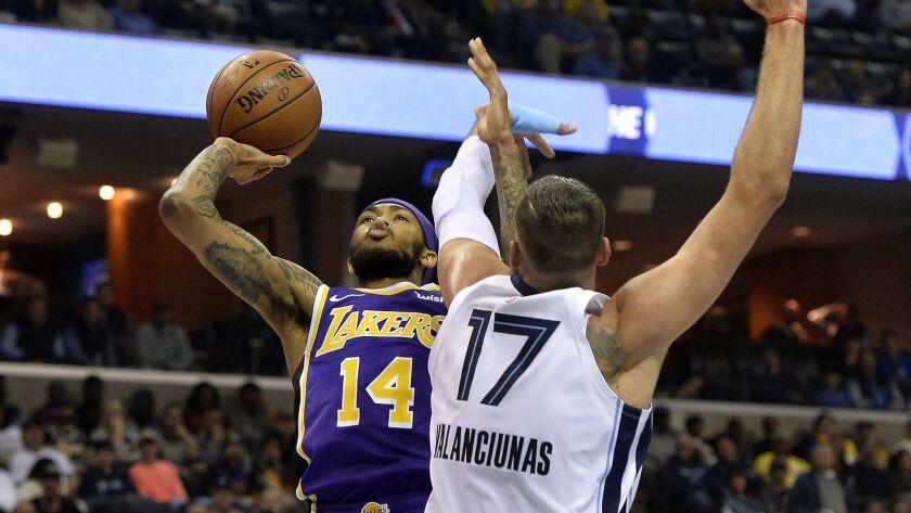 Los Angeles Lakers forward Brandon Ingram (14) shoots against Memphis Grizzlies center Jonas Valanci