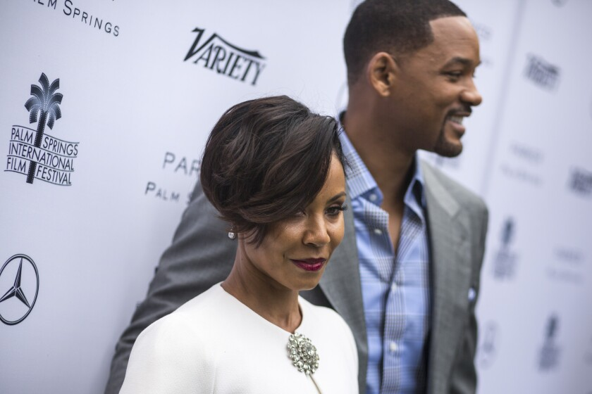 Actors Jada Pinkett Smith, left and Will Smith before the start of the Variety magazine luncheon, at the 2016 Palm Springs International Film Festival on Jan. 03, 2016.