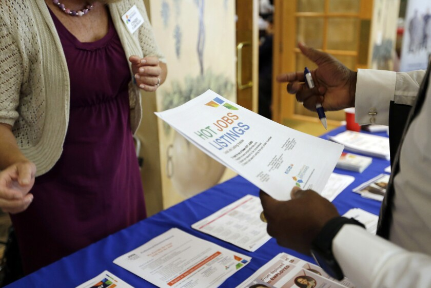 A veteran speaks with an outreach representative at a jobs fair in Florida last year.