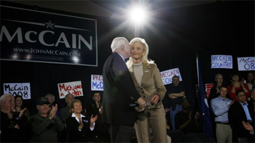 Republican presidential hopeful, Sen. John McCain, left., kisses his wife Cindy after she introduces him at a campaign rally at Hope College in Holland, Mich.