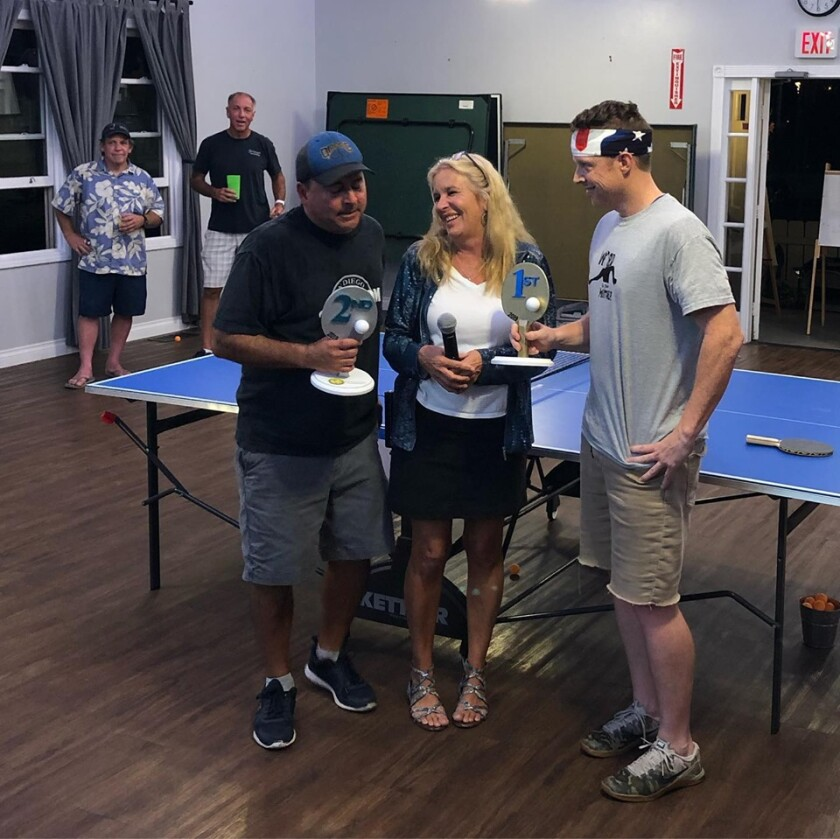 Winkie presents Golden Paddles to first place winner Patrick Gallagher and second place champ Lionel Silva