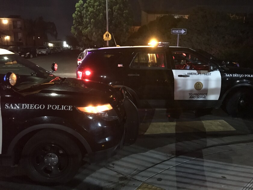San Diego police vehicles parked near scene of city Heights homicide