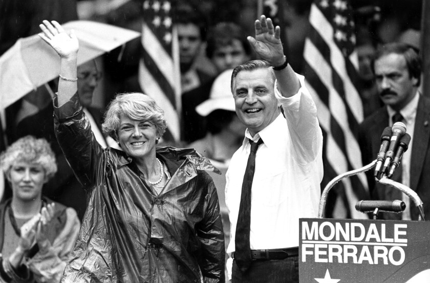 Black-and-white photograph of Walter Mondale, right, with Geraldine Ferraro, both of whom are waving
