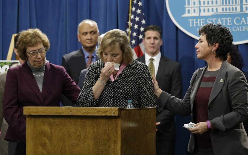 Debbie Ziegler, center, the mother of Brittany Maynard, is comforted by state Sen. Lois Wolk (D-Davis), left, and Assemblymember Susan Talamantes Eggman (D-Stockton) as she appeared in January in support of proposed legislation allowing doctors to prescribe life-ending medication to terminally ill patients. Maynard, a 29-year-old San Francisco Bay Area woman who had terminal brain cancer, ended her own life.