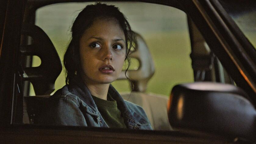 """Noée Abita sitting in a car in """"Genèse."""""""