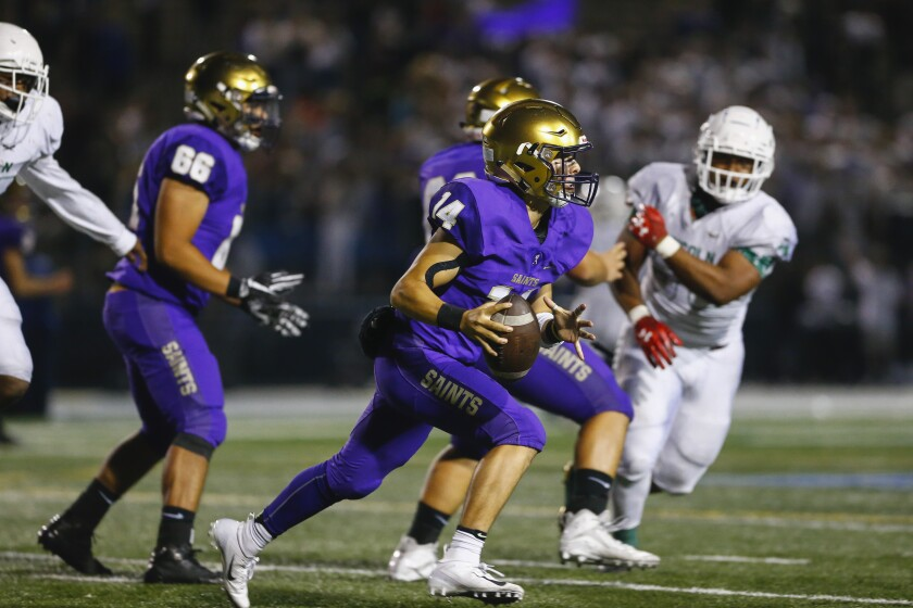 St. Augustine quarterback Angelo Peraza (14) rushes during the second quarter against Lincoln.