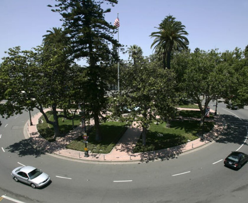 Cars make their way around the traffic circle at Orange Plaza in Historic Old Towne Orange. Many people still refer to the area as the Orange Circle. It is off Chapman Ave. and branches off to Glassell St. The traffic was moving on a Wednesday May 28, 2008. The view is seen from atop the Wells FArgo Bank.