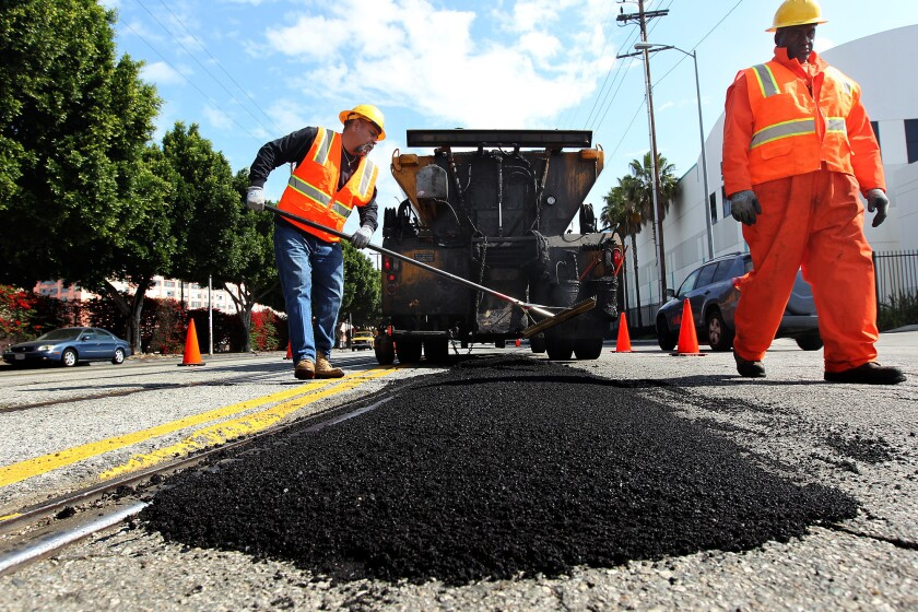 A city of Los Angeles Street Services crew fills a pothole.