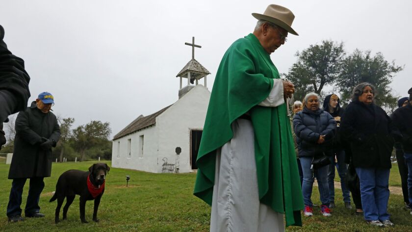 MISSION, TEXAS--FEB. 8, 2019--Rev. Roy Snipes leads a prayer at La Lomita chapel Friday morning for