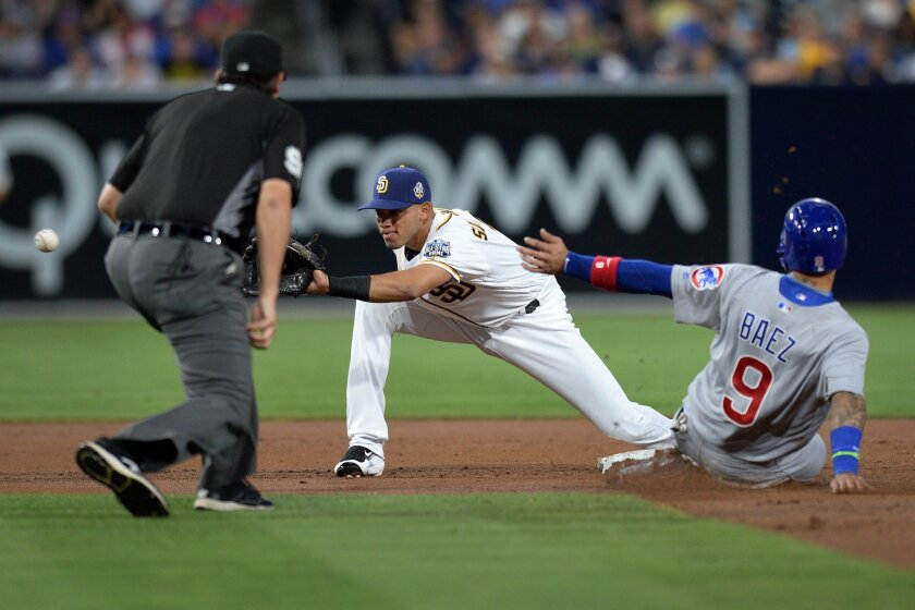 Chicago Cubs third baseman Javier Baez (9) steals second ahead of the throw to San Diego Padres second baseman Luis Sardinas (C) during the second inning at Petco Park. (Jake Roth/USA TODAY Sports)