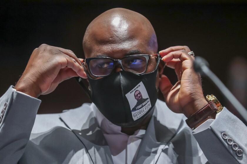 Philonise Floyd, a brother of George Floyd, arrives to testify before a House Judiciary Committee hearing on proposed changes to police practices and accountability on Capitol Hill, Wednesday, June 10, 2020, in Washington. (Michael Reynolds/Pool via AP)