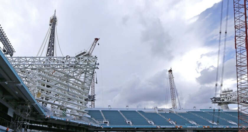 A truss holds a structural support of one of four spires that will be 200 feet above the roof surface and 357 feet from the ground, at the Miami Dolphins' NFL football stadium Thursday, June 2, 2016, in Miami Gardens, Fla. Several steel cables secured at the top of each spire will be extended to th