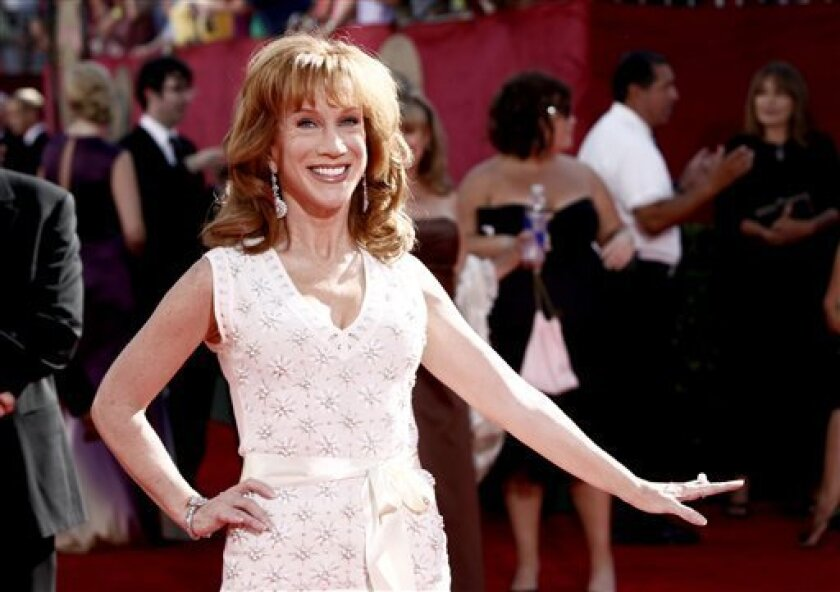 "FILE - In this Sunday, Sept. 20, 2009 picture, Kathy Griffin arrives at the 61st Primetime Emmy Awards in Los Angeles. For the second straight year, comedian Griffin ushered in the new year by saying something vulgar on CNN. During the network's live New Year's Eve broadcast from Times Square, Griffin was joking with co-host Anderson Cooper about how to pronounce the first name of ""balloon boy"" Falcon Heene when she mumbled something that sounded like the F-word. Cooper shook his head and said ""You're terrible."" (AP Photo/Matt Sayles)"