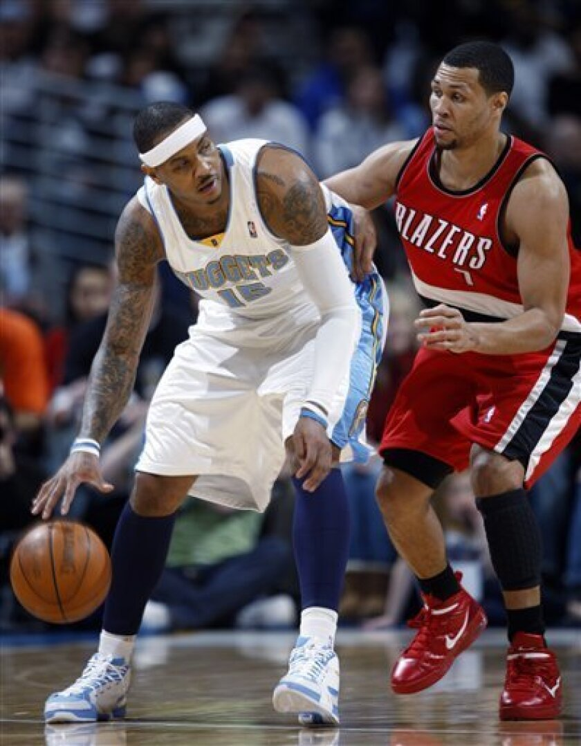 Denver Nuggets forward Carmelo Anthony, left, works the ball inside as Portland Trail Blazers guard Brandon Roy defends in the first quarter of an NBA basketball game in Denver on Sunday, March 7, 2010. (AP Photo/David Zalubowski)