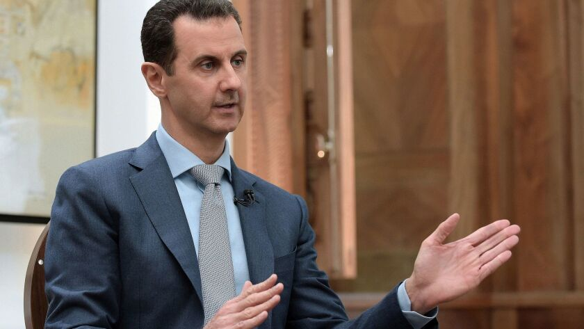 Forces believed to be loyal to Syrian President Bashar Assad, here in Damascus in February, were attacked by warplanes of a U.S.-led coalition.