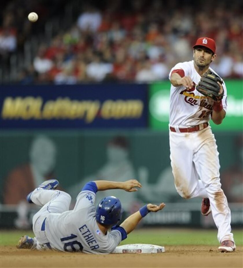 St. Louis Cardinals' Matt Carpenter (13) forces out Los Angeles Dodgers' Andre Ethier (16) but can't complete the double play as the Dodgers' A.J. Ellis is safe at first in the fourth inning in a baseball game Monday, August 5, 2013, at Busch Stadium in St. Louis. (AP Photo/Bill Boyce)