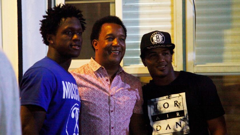 MLB Hall of Famer Pedro Martinez, center, stopped by the home of friend Moises Alou on Jan. 31 during a team dinner in Santo Domingo, Dominican Republic.