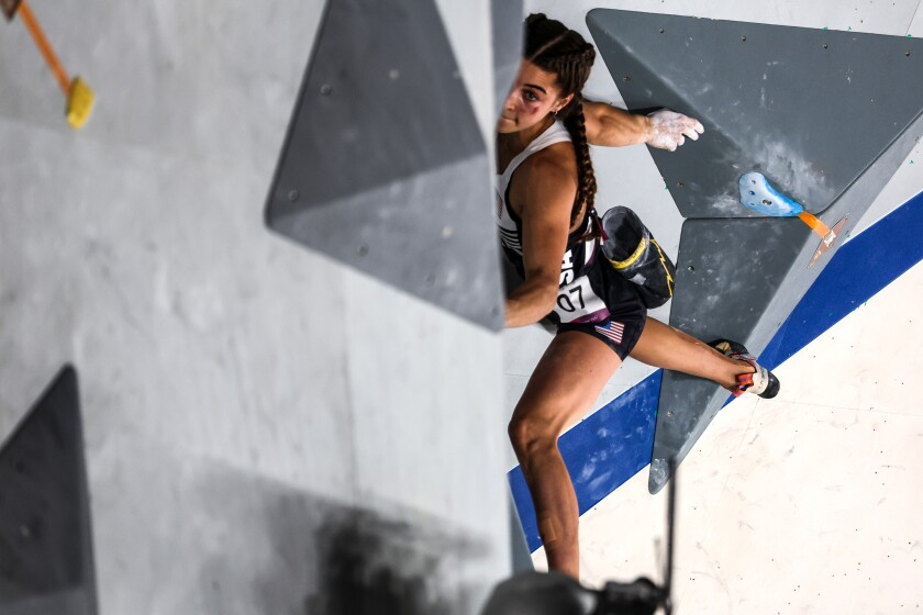 U.S. climber Brooke Raboutou struggles to make a transition during the bouldering portion of the women's sport climbing final