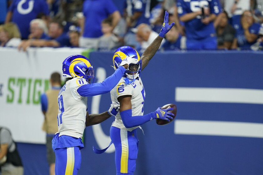 Rams cornerback Jalen Ramsey (5) celebrates his game-clinching interception against the Colts with Darious Williams.