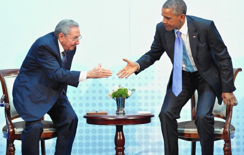 President Obama and Cuban President Raul Castro greet each other in Panama City, as relations were thawing last April.