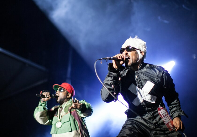Big Boi, left, and Andre 3000 of Outkast perform at Counterpoint 2014 Sunday, April 27, 2014, in Rome, Ga. (AP Photo/Branden Camp)
