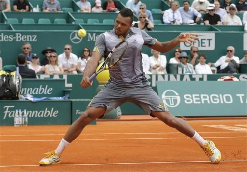 France's Jo-Wilfried Tsonga plays a return to Stanislas Wawrinka of Switzerland during their quarter final match of the Monte Carlo Tennis Masters tournament in Monaco, Friday, April 19, 2013. (AP Photo/Lionel Cironneau)