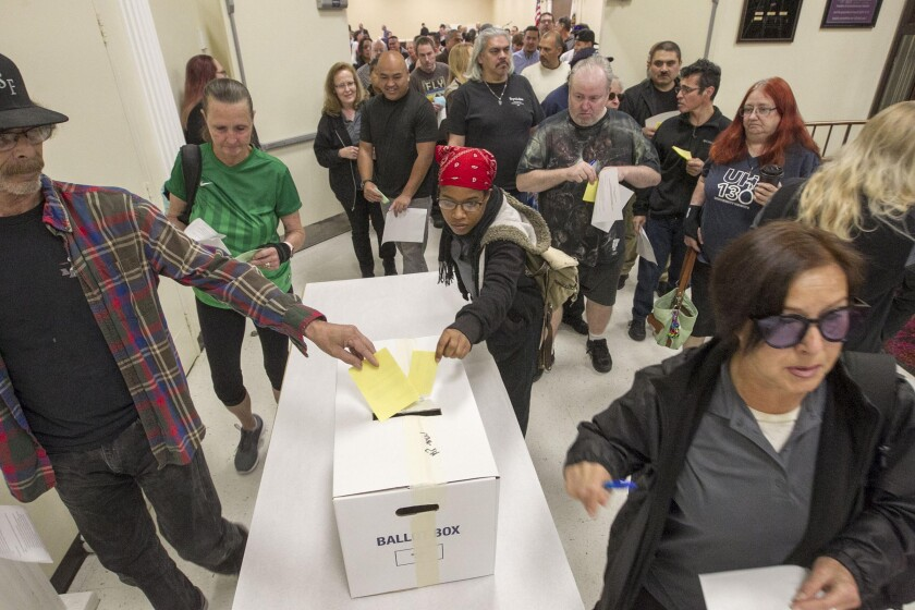 Grocery store workers from Ralphs, Vons and Albertsons deposited their ballots after voting Monday on whether to authorize a strike should future negotiations stall. The vote was the first of three sessions held at the Scottish Rite Center by UFCW 135.
