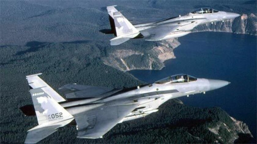AGING FIGHTERS: The Air Force hopes to replace its F-15 Eagles. Above, two of the jet fighters in flight over Crater Lake, Oregon.