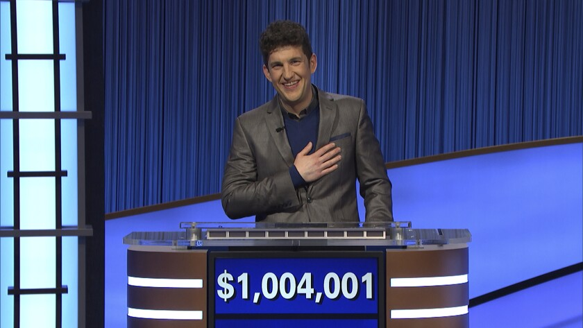 """This photo provided by Jeopardy Productions Inc. shows """"Jeopardy!"""" contestant Matt Amodio's after his total win amount was announced, Friday, Sept. 24, 2021. Amodio, a fifth-year computer science Ph.D student at Yale University, won $48,800 for his 28th victory, bringing his total winnings to $1,004,001. (Jeopardy Productions Inc. via AP)"""