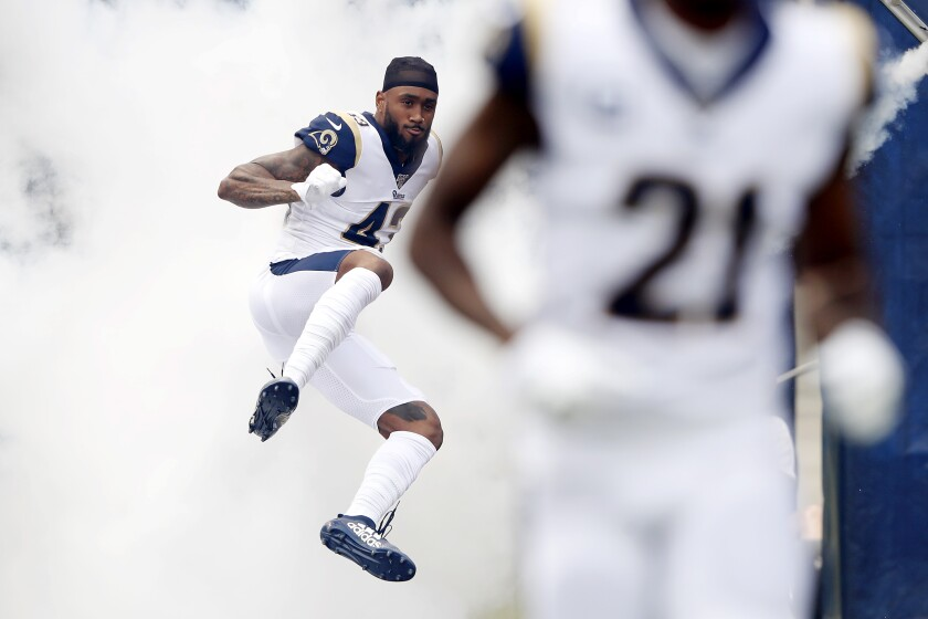Rams safety John Johnson jumps onto the field before a game against the New Orleans Saints on Sept. 15.