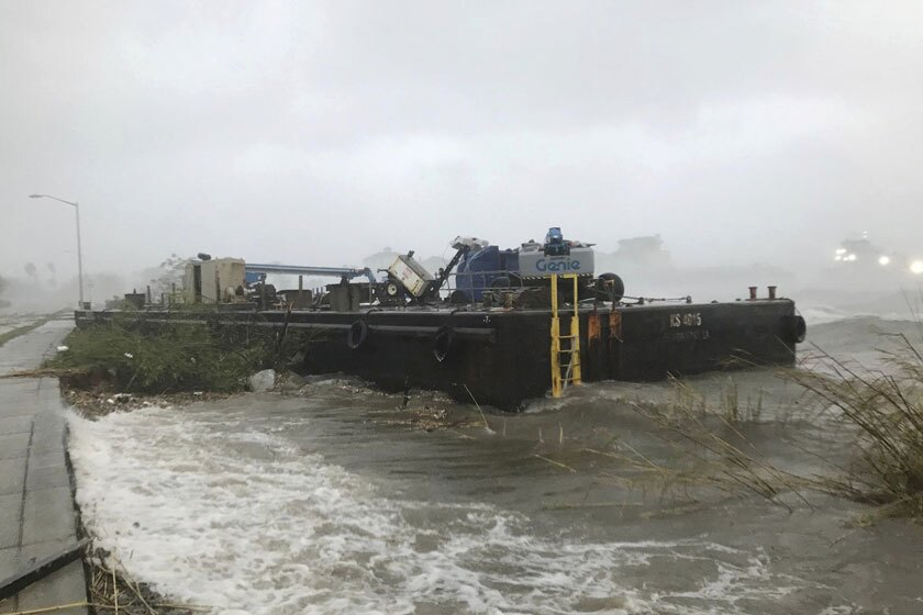 A barge runs aground in Pensacola, Fla., on Wednesday.
