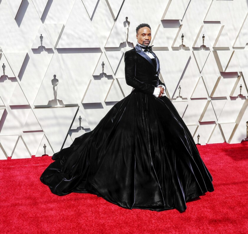 At the 2019 Oscars, Billy Porter wears a custom Christian Siriano creation that deftly melds the most striking elements of men's and women's formalwear.