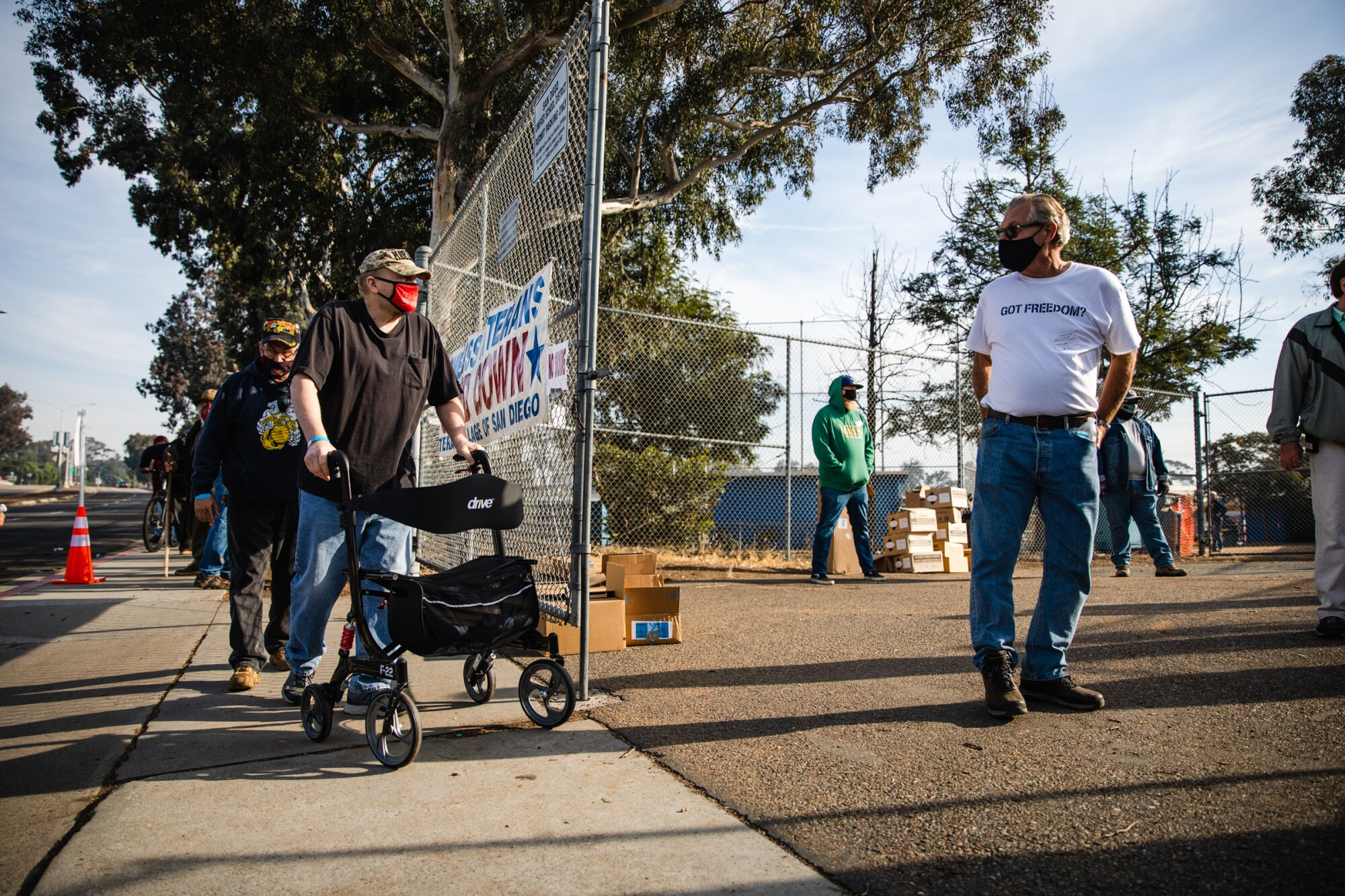 """Veterans wait outside San Diego High School to participate in the annual """"Stand Down"""" event."""