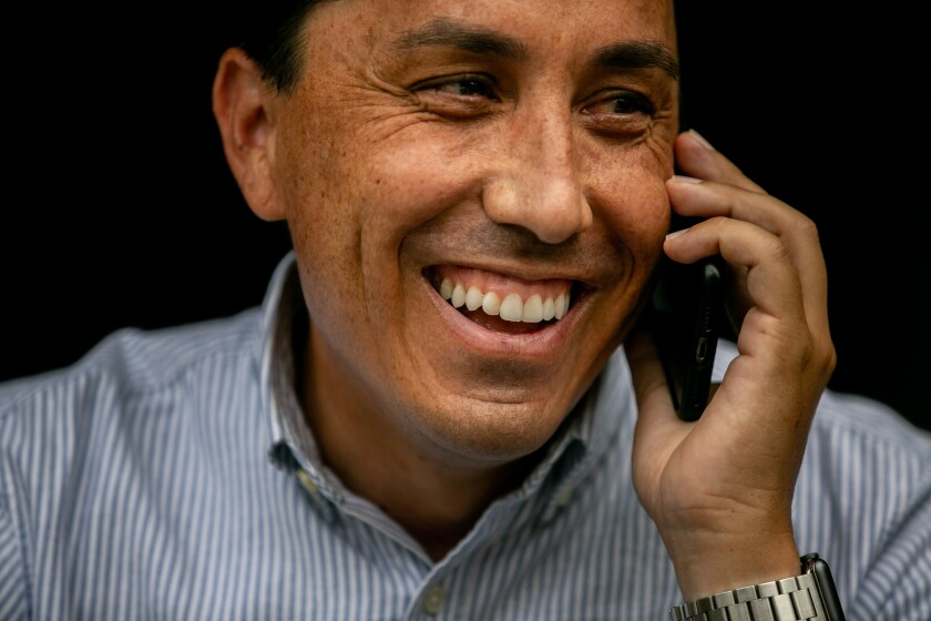 Todd Gloria, who is on track to be mayor-elect of San Diego, takes a phone call at his home last week.